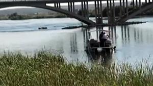 Polisten kaçmak için Fırat Nehri'ne atladı